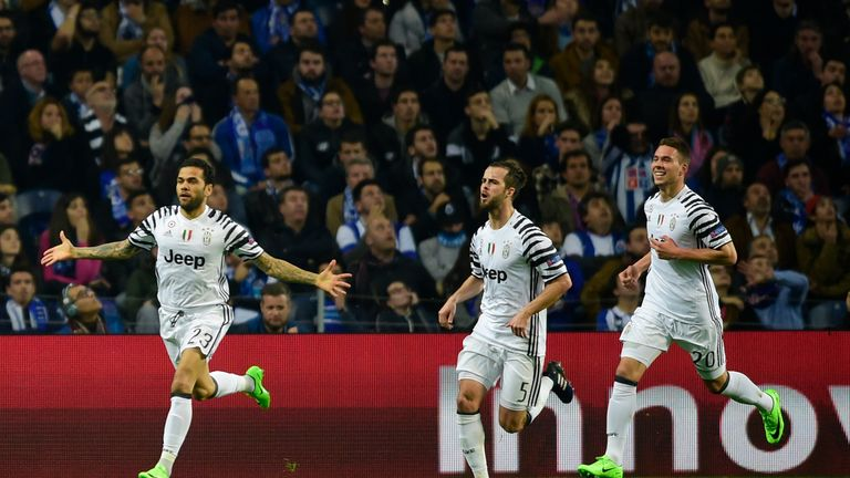 Dani Alves celebrates after putting Juventus ahead in the first leg