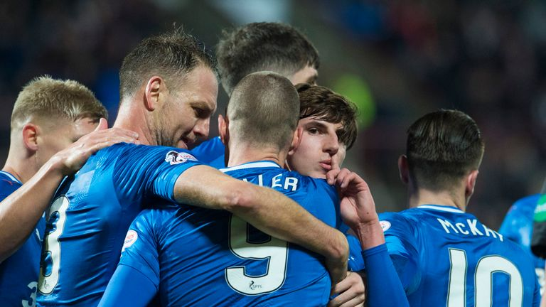 Emerson Hyndman (centre) is mobbed by his Rangers team-mates after scoring the equaliser
