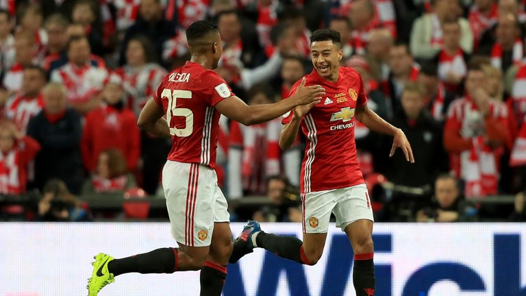 Jesse Lingard (right) celebrates his goal with Antonio Valencia