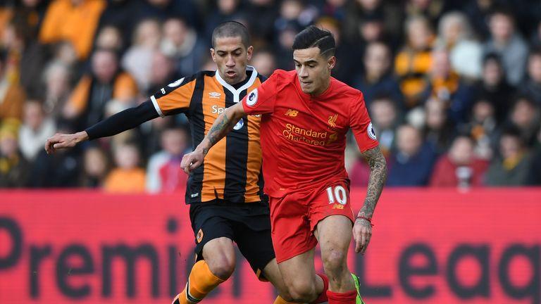 Philippe Coutinho looks to avoid Hull midfielder Evandro