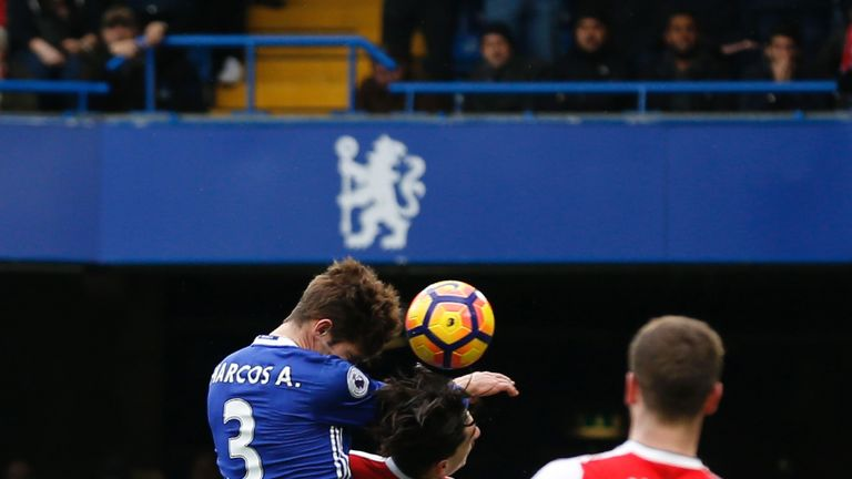 Marcos Alonso (left) rises above Hector Bellerin to head Chelsea into a 1-0 lead