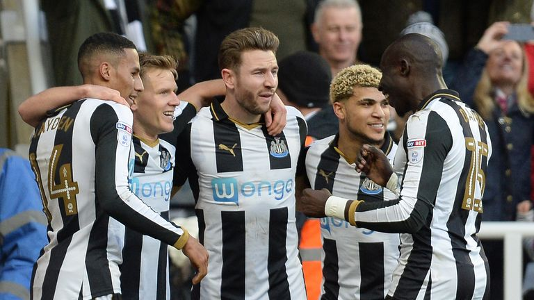 Ritchie celebrates with team-mates after scoring his side's goal