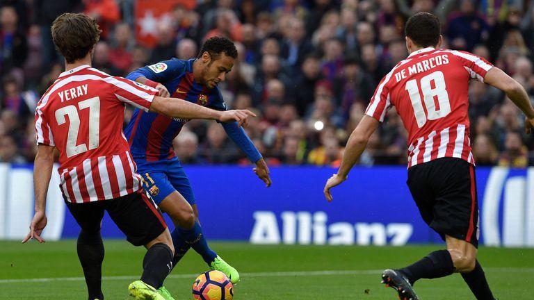 Neymar vies with Athletic Bilbao's Yeray Alvarez (left) and  midfielder Oscar de Marcos during today's 3-0 victory