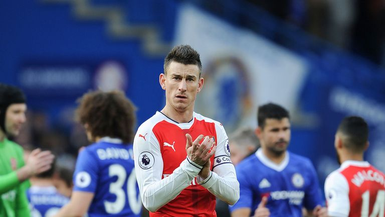 Laurent Koscielny applauds the Arsenal fans after the 3-1 defeat by Chelsea at Stamford Bridge
