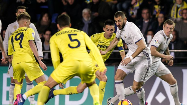 Real Madrid's French forward, Karim Benzema in action against Villarreal