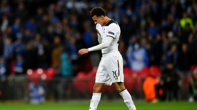 Dele Alli leaves the Wembley turf after his red card against Gent