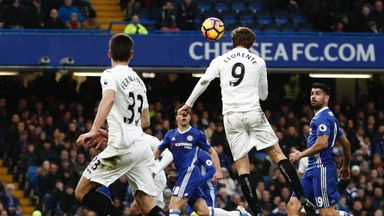 Swansea City's Spanish striker Fernando Llorente (2R) scores an equalising goal for 1-1 during the English Premier League football match between Chelsea an