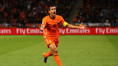 Giovanni van Bronckhorst celebrates scoring for the Netherlands in their 2010 World Cup semi-final against Uruguay