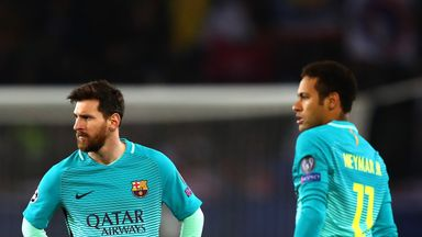 Lionel Messi and Neymar of Barcelona look on during the UEFA Champions League Round of 16 first leg match between Paris Saint-Germain