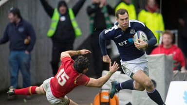 Tim Visser beats Leigh Halfpenny to score Scotland's second try