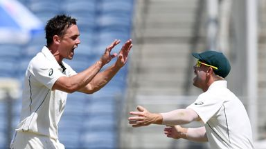 Australia's Steve O'Keefe (L) celebrates one of his six wickets with team-mate David Warner