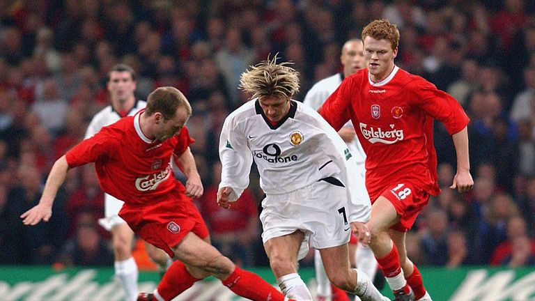 CARDIFF, WALES - MARCH 2:   David Beckham battles for the ball with Liverpool's Danny Murphy during the Worthington Cup Final between Manchester United v L