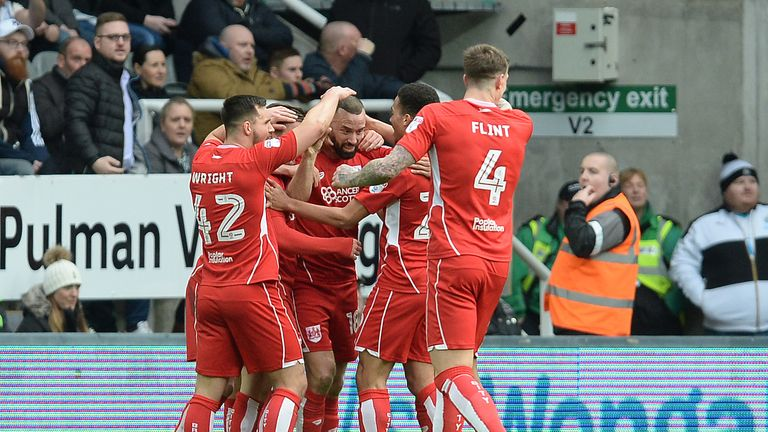 Bristol City celebrate after Aaron Wilbraham (centre) scores their first goal during the Sky Bet Championship match at St James' Park, Newcastle.
