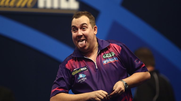 Kim Huybrechts of Belgium celebrates winning his second round match against Ian White