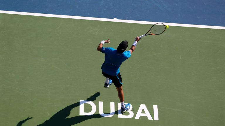 Malek Jaziri hits a return to Mikhail Youzhny during their ATP tennis match on the first round of the Dubai Duty Free Tennis Championships, 2016