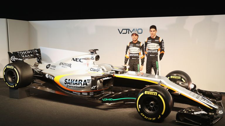 Sergio Perez and Esteban Ocon of Force India pose with the VJM10 during the unveiling at Silverstone