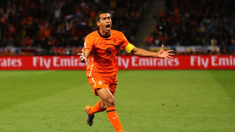 Giovanni van Bronckhorst celebrates scoring for the Netherlands in their 2010 World Cup semi-final
