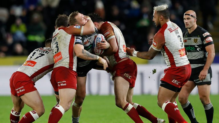 Hull FC's Josh Griffin is challenged by Catalans Dragons' Greg Bird and Justion Horo during the Betfred Super League match at the KCOM Stadium, Hull.