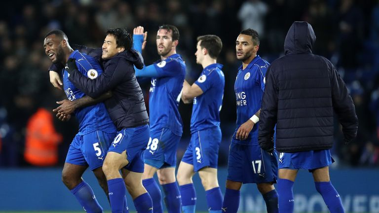 LEICESTER, ENGLAND - FEBRUARY 27:  Wes Morgan of Leicester City (L) celebrates with team mates  after the full time whistle during the Premier League match