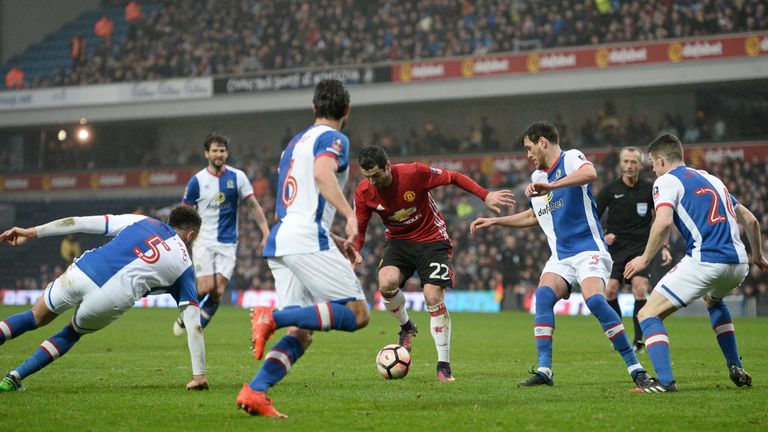 Manchester United's Armenian midfielder Henrikh Mkhitaryan (C) controls the ball during the English FA Cup fifth round football match between Blackburn Rov
