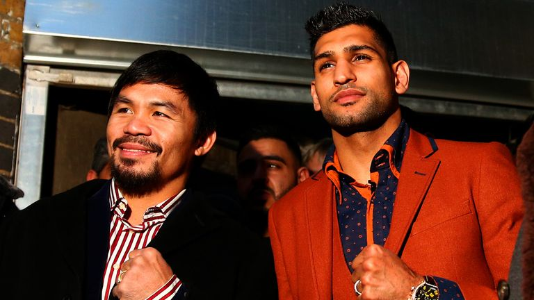 LONDON, ENGLAND - JANUARY 23:  Manny Pacquiao and Amir Khan pose after holding discussions about the possibility of a future fight, at Fitzroy Lodge Amateu