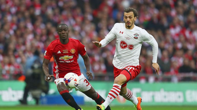 Manolo Gabbiadini takes on Eric Bailly during the first-half of the EFL Cup Final at Wembley