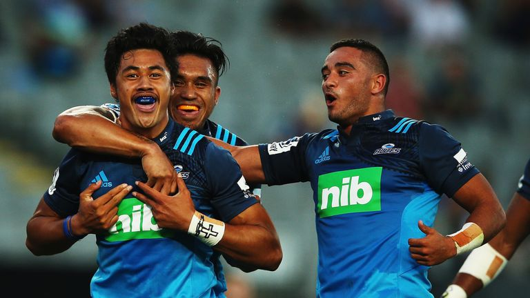 AUCKLAND, NEW ZEALAND - FEBRUARY 26 2016:  Melani Nanai of the Blues celebrates after scoring a try with Male Sau and Bryn Hall