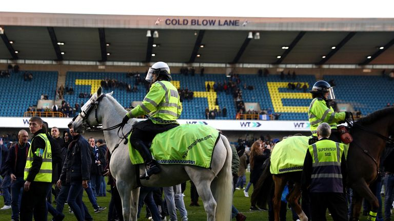 LONDON, ENGLAND - FEBRUARY 18:  Police on horseback take control of the pitch invaders after The Emirates FA Cup Fifth Round match between Millwall and Lei