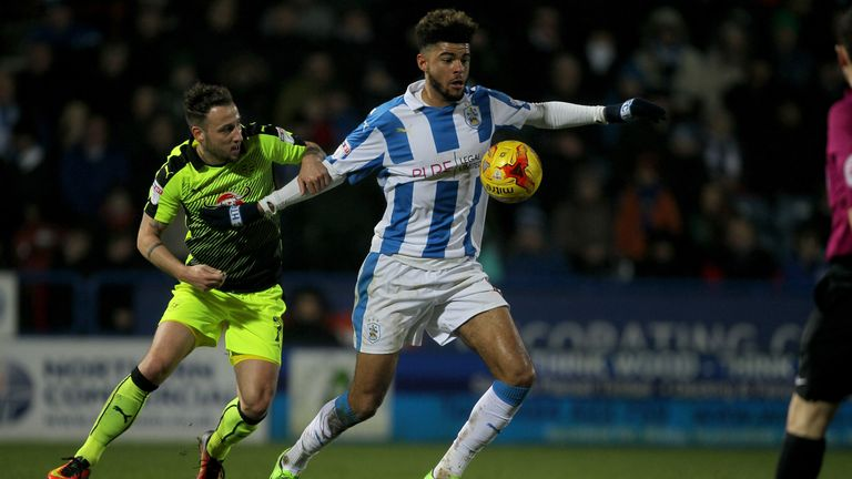 Huddersfield Town's Philip Billing (right) is challenged by Reading's Roy Beerens during the Sky Bet Championship match at the John Smith's Stadium