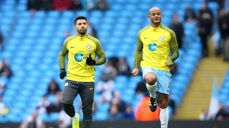 Sergio Aguero and Vincent Kompany of Manchester City warm up prior to the Premier League match v Swansea