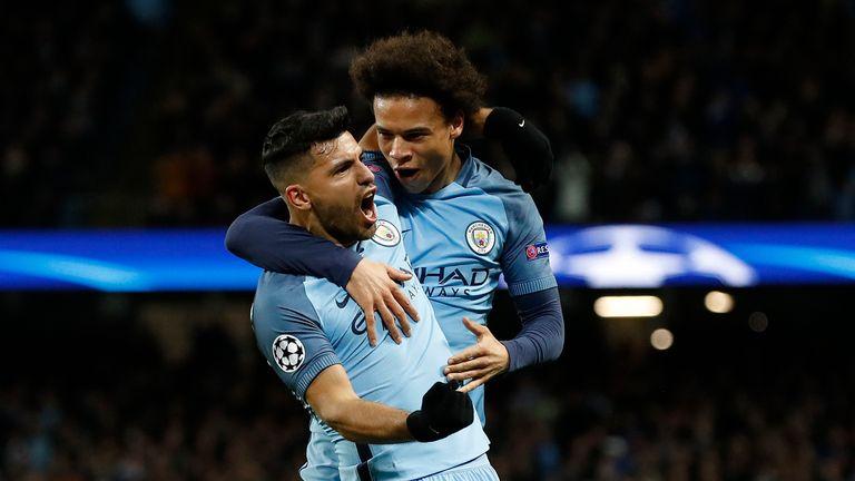 Manchester City's Sergio Aguero celebrates scoring his sides third goal with Leroy Sane