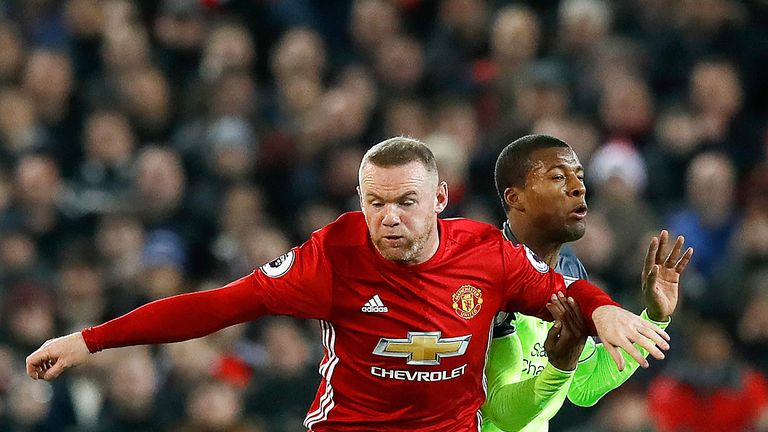 Wayne Rooney and Georginio Wijnaldum battle for the ball during the Premier League match at Old Trafford