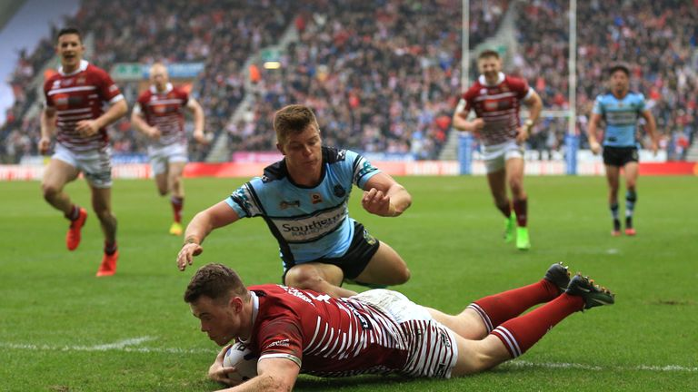 Wigan Warriors' Joe Burgess scores his sides second try of the game against Cronulla-Sutherland Sharks during the 2017 Dacia World Club Series match at the