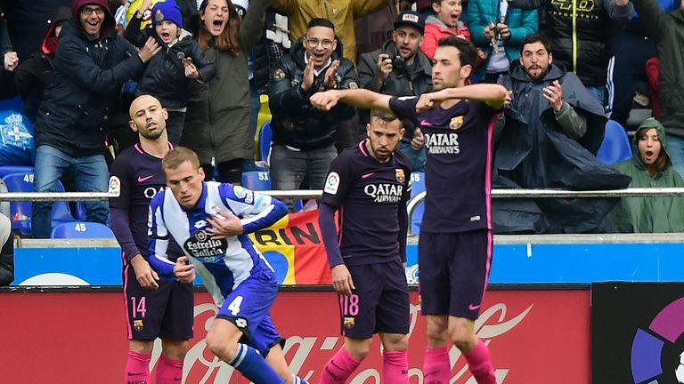 Barcelona players look on as Alex Bergantinos celebrates Deportivo's winner
