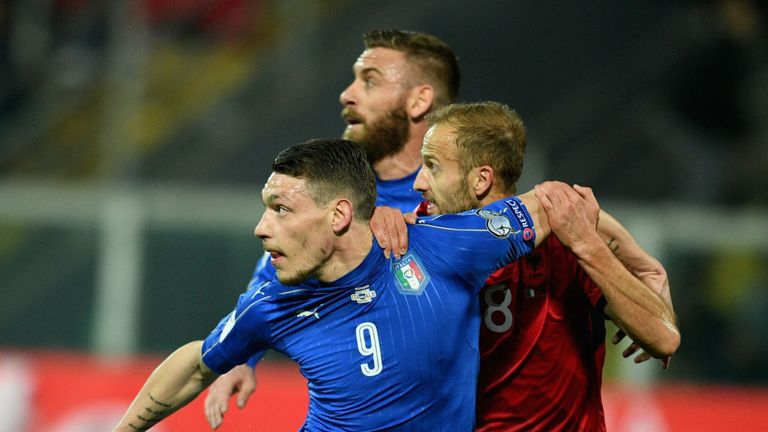 Andrea Belotti of Italy (left)  competes for the ball with Naser Aliji