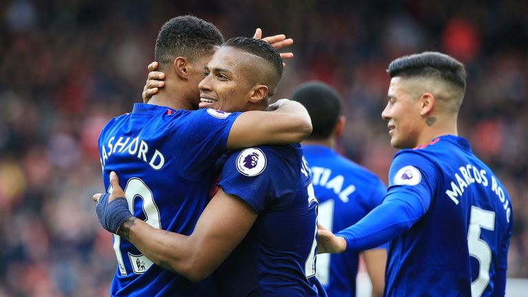 Antonio Valencia celebrates with team-mates after scoring Manchester United's third goal against Middlesbrough