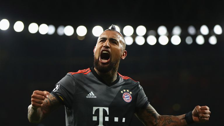 Arturo Vidal scored twice towards the end to compound Arsenal's misery