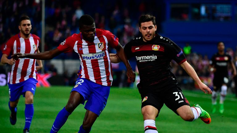 Thomas Partey and Kevin Volland jostle for possession at the Vicente Calderon