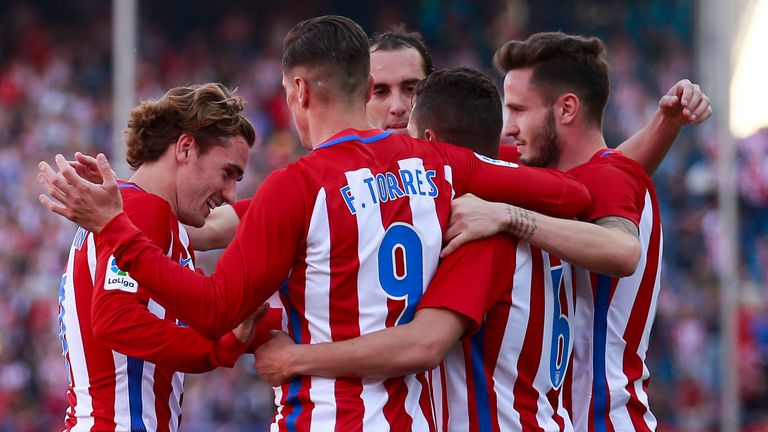 Koke (second right) celebrates scoring the third goal