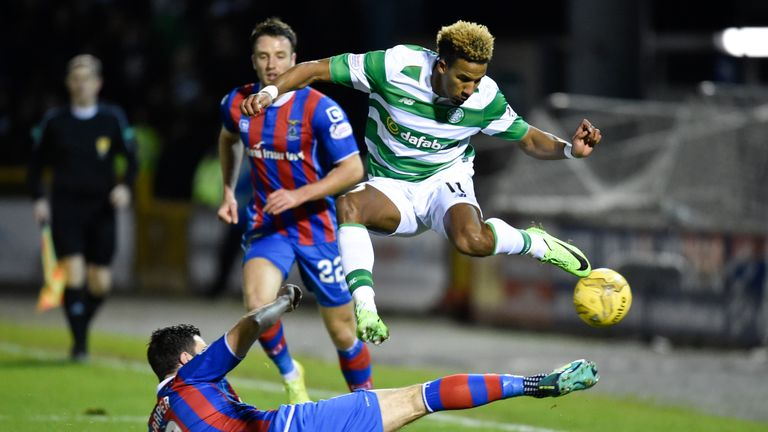 Celtic's Scott Sinclair (right) is tackled by Ross Draper