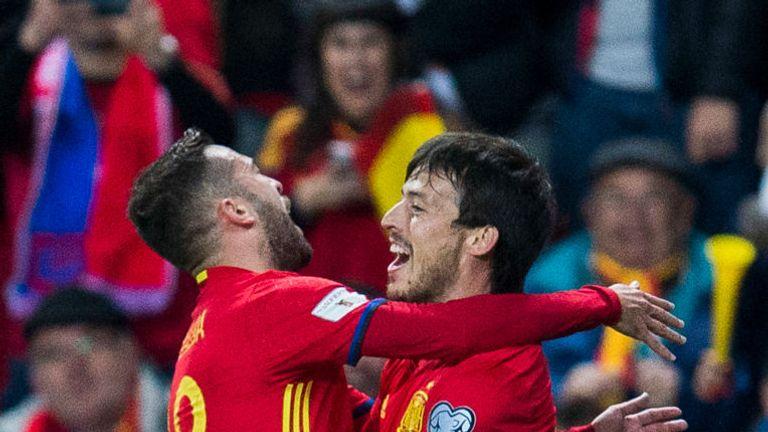 David Silva (right) celebrates with Jordi Alba