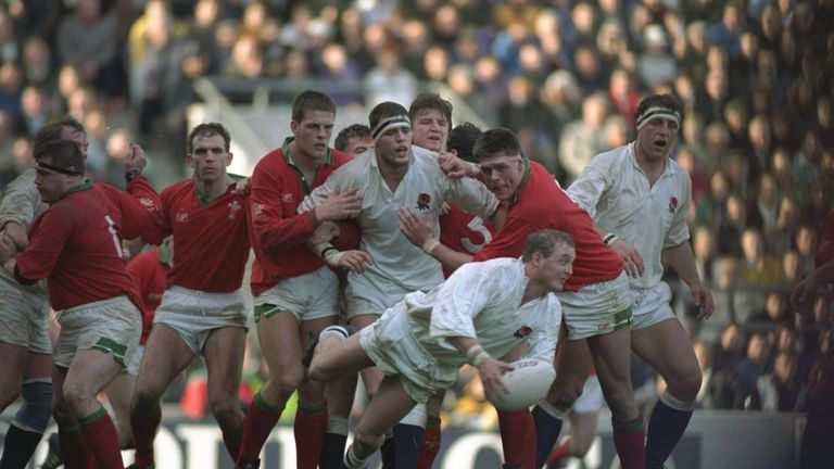 Morris passes the ball as the English and Welsh forwards look on during the match in March 1992