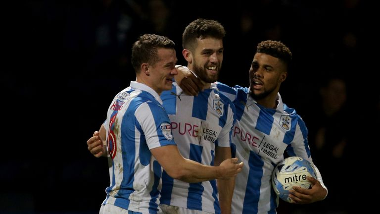 Huddersfield Town's Tommy Smith (centre) is congratulated after scoring the winner against Aston Villa