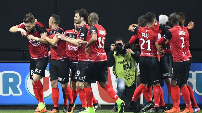 Guingamp's players celebrate their winner against Nancy