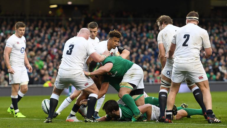 Iain Henderson stretches out to score against England