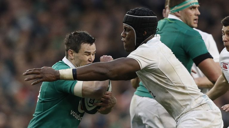 England flanker Maro Itoje (right) tackles Ireland's fly-half Johnny Sexton