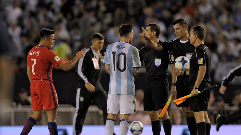 Messi speaks with the officials after the game against Chile