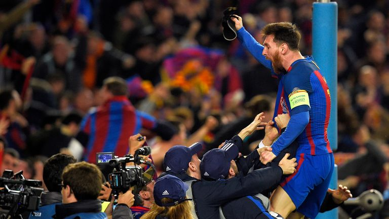 Barcelona captain Lionel Messi celebrates after sealing qualification to the Champions League quarter-finals