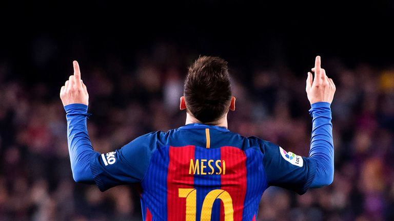 Lionel Messi celebrates his second goal against Valencia