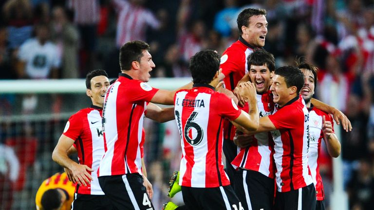 Mikel San Jose is mobbed by his team-mates after scoring against Barcelona